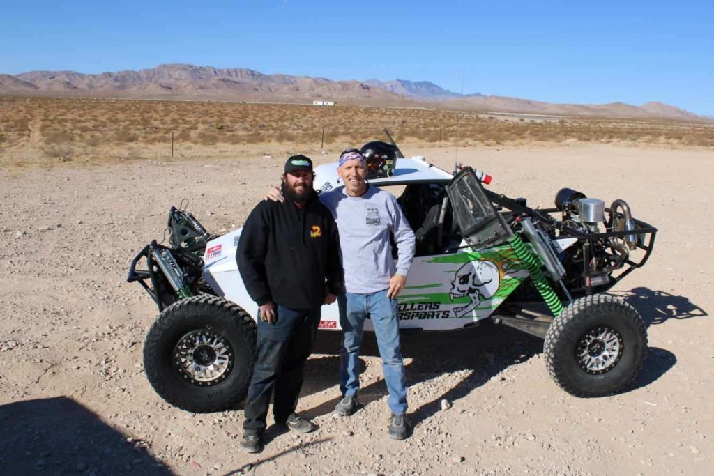 Chief Mechanic Billy Shapley, left, is seen with fellow off-road racer, John Pellissier, who is prepared to is ready to compete Dec. 10-13. Pellissier and car owner Richard Seibel Rud are celebrating the 30th anniversary of their first race together which was the 1990 SNORE Showboat 250 debuting the new car.